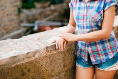 Girl in plaid shirt and short shorts.  Royalty Free Stock Photo
