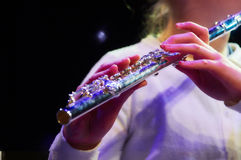 Girl plaing on flute Stock Image