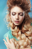Girl with Plait and Intertwined Flowers Stock Photography