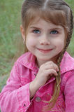 Girl plaiting her hair Royalty Free Stock Image