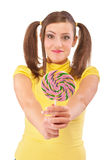 Girl with plaits holds lolipop Stock Photos