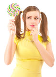 Girl with plaits holds lolipop Stock Images