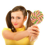 Girl with plaits holds lolipop Stock Image