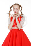 Girl with plaits in russian folk costume Royalty Free Stock Photos