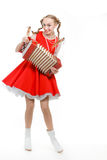 Girl with plaits in russian folk costume with acco Stock Images