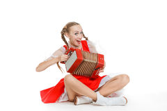 Girl with plaits in russian folk costume with acco Royalty Free Stock Photography
