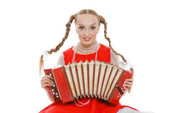Girl with plaits in russian folk costume with acco Stock Photography