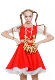 Girl with plaits in russian folk costume with bara Stock Photos