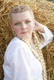 The girl with plaits in a white shirt Stock Image