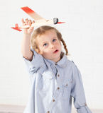 Girl with plane Royalty Free Stock Images