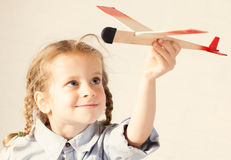 Girl with plane Stock Photo