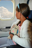 Girl on a plane Royalty Free Stock Photos