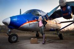 Girl at the plane Stock Photos