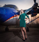 Girl  at the plane Stock Image