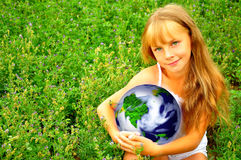 Girl with planet. Green-eyed girl with planet in her hand Stock Images