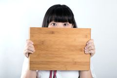 Girl with plank. Board background royalty free stock photos
