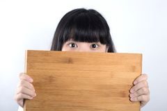 Girl with plank. Board background stock photography