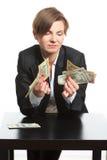 Girl plans to budget. Dollar said Stock Photo