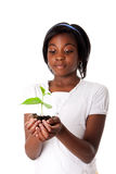 Girl with plant in hand Royalty Free Stock Image