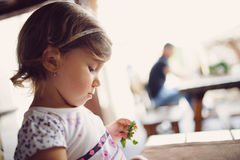 Girl with Plant Stock Image