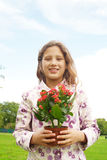 Girl with plant pot in park. Royalty Free Stock Photo