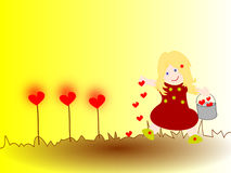 Girl plants hearts , what goes around will grow. Girl plants hearts in the ground, what goes around will grow Stock Photo