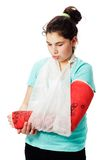 Girl with plaster cast pouting Royalty Free Stock Image