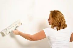 Girl plastering Stock Photography