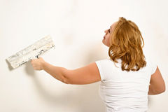 Girl plastering Royalty Free Stock Images