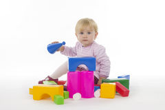 Girl with plastic cubes. Royalty Free Stock Photography