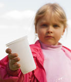 Girl with a plastic cup Royalty Free Stock Images