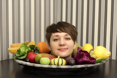 Girl and plate of fruits Royalty Free Stock Image