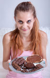 Girl with plate full of sweets Stock Photos