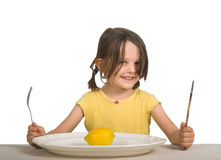 Girl with plate and lemon Stock Photos