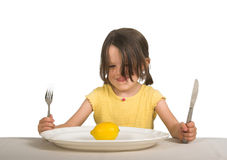 Girl with plate and lemon Stock Images