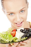 Girl with plate of salad. Beautiful caucasian girl with a plate of vegetable salad, close-up portrait, isolated on white Stock Photography