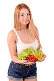 Girl with a plate of vegetables. Girl with a plate of tasty tomatoes stock images