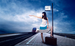 Girl on the platform. Girl waiting train on the platform of railway station Royalty Free Stock Photography