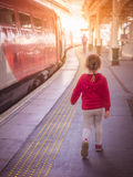 Girl on the platform on the train station Royalty Free Stock Image