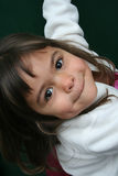 Girl at play. Young girl at play with brown hair and dimples Royalty Free Stock Images