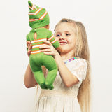 Girl play with baby doll. Mothers day concept. Stock Photos