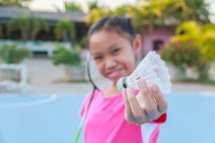 Girl play badminton Stock Photo