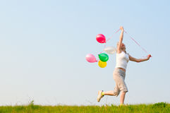 Girl play with balloons Stock Photo