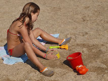 Girl play on the beach Royalty Free Stock Photo