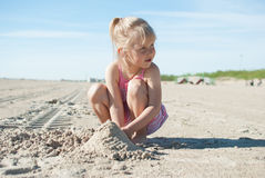 Girl play beach sand Stock Photos