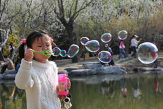 Girl play bubbles. Chinese girl Stock Photography