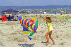 Girl play with colorful sailing ship kite Stock Images
