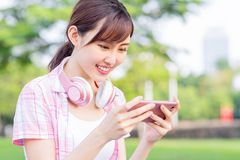Girl play game on phone royalty free stock photos