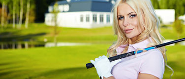 Girl play golf. Beauty blonde girl play golf Stock Image