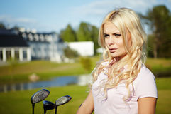 Girl play golf Stock Images
